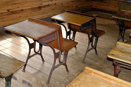 Image of antique school desks.